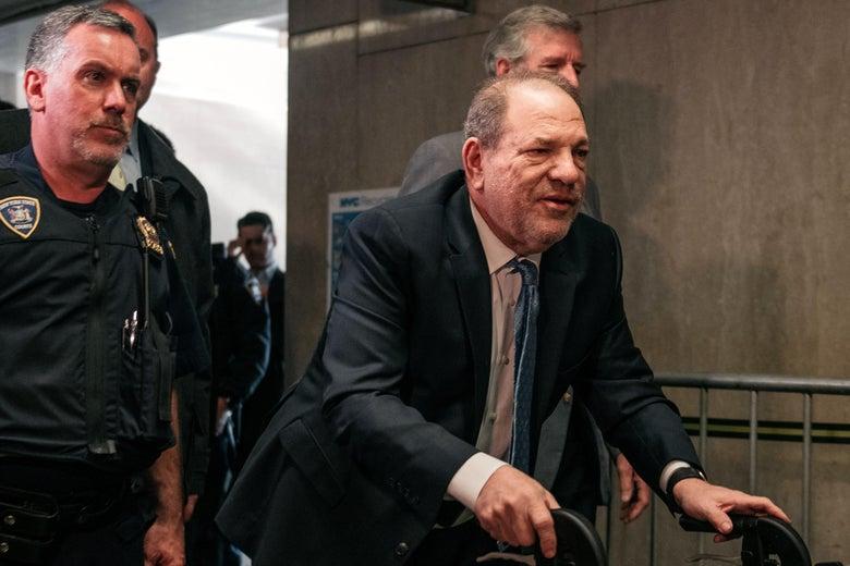 Harvey Weinstein walks into court with a walker.