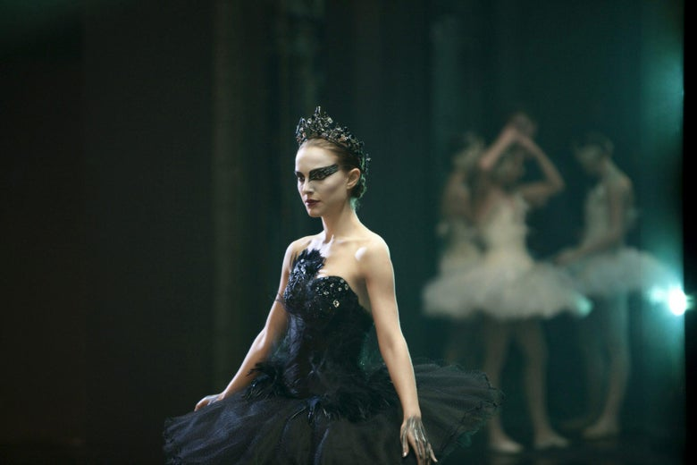 A ballerina in a black tutu looks stressed and concerned.