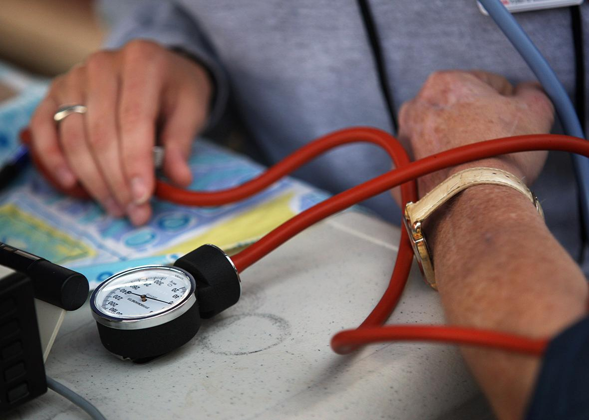 A nurse checks a patient's blood pressure at the Remote Area Medical health care clinic in Wise, Virginia.