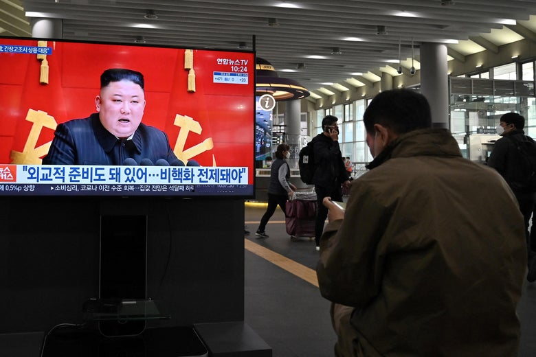 People watch a television screen at Suseo railway station in Seoul on March 26, 2021, showing file footage of North Korea's leader Kim Jong Un.
