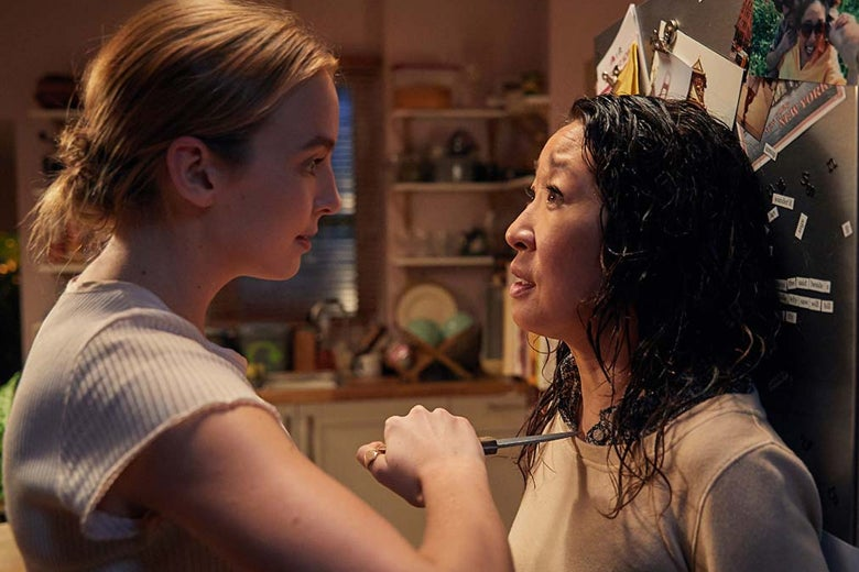 Jodie Comer holds a knife to Sandra Oh's chest in a still from Killing Eve.
