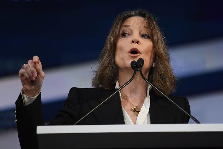 Marianne Williamson speaks at a podium