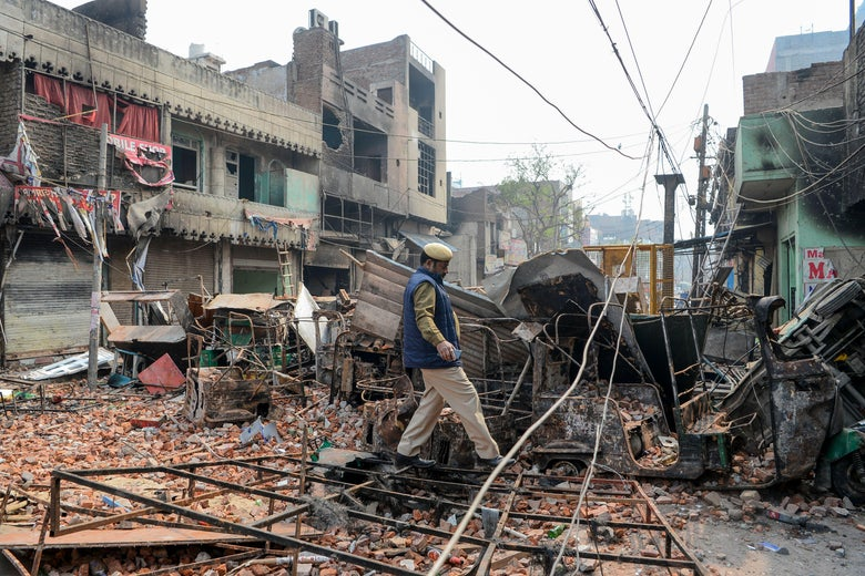 A man walks amid rubble.