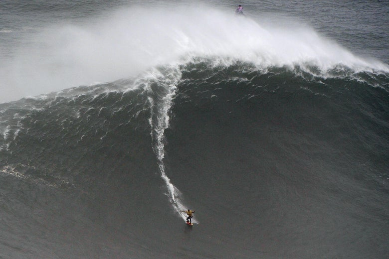 Spanish surfer Axier Muniain rides a gigantic wave.