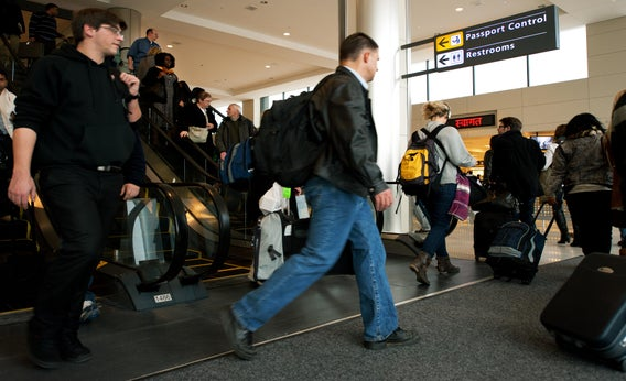 International air travelers entering the United States head to 'Passport Control' inside the US Customs and Immigration area.