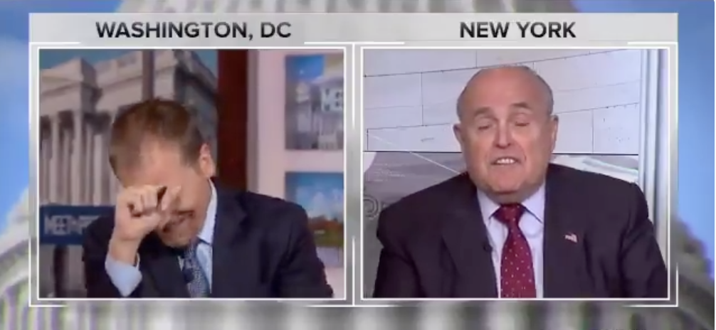 "NBC's Chuck Todd reacts as Rudy Giuliani insists ""truth isn't truth"" during an interview on August 19, 2018."