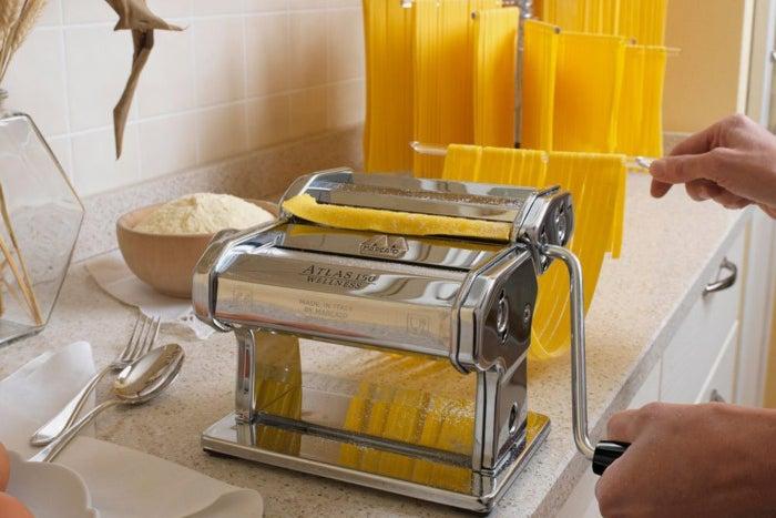 Person using a Marcato Atlas Pasta Machine to make pasta.