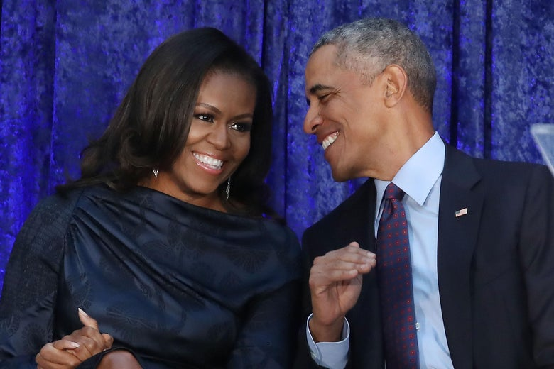 Michelle and Barack Obama at the unveiling of their official portraits.