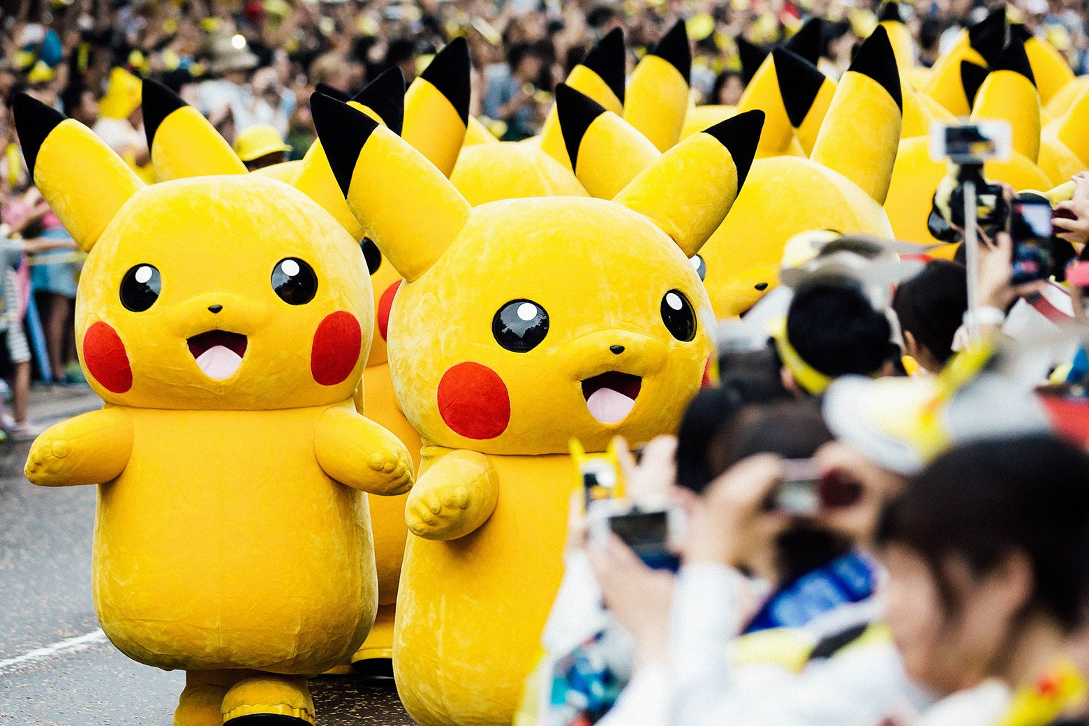 Performers dressed as Pikachu march during a parade held as part of an event hosted by The Pokemon Co. on Aug. 14, 2017, in Yokohama, Kanagawa, Japan.