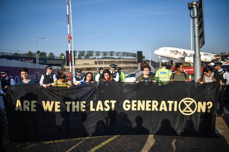 Climate protestors hold a demonstration outside Heathrow Airport.