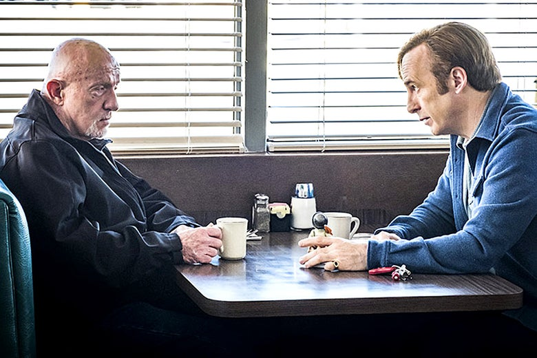 In a scene from Better Call Saul, Mike Ehrmantraut (Jonathan Banks) and Jimmy McGill (Bob Odenkirk) sit across from each other at a table.