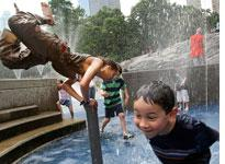 Children playing in a Central Park fountain.