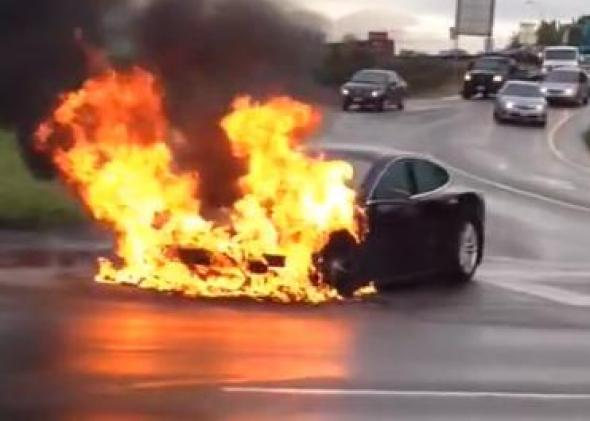 A Tesla Model S' battery burns by the side of a freeway in a Seattle suburb.