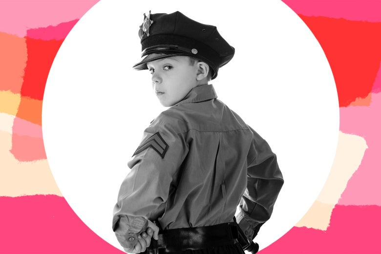 White 5-year-old boy dressed up as a police officer.