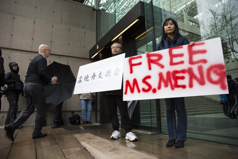 Demonstrators hold signs in support of Huawei CFO Meng Wanzhou outside her bail hearing at British Columbia Superior Courts on Dec. 11, 2018.