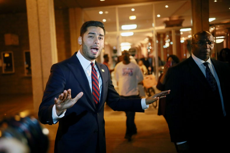 Ammar Campa-Najjar with his hands outstretched.