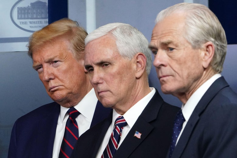 Donald Trump, Mike Pence, and Peter Navarro, all wearing suits, look in the same direction.