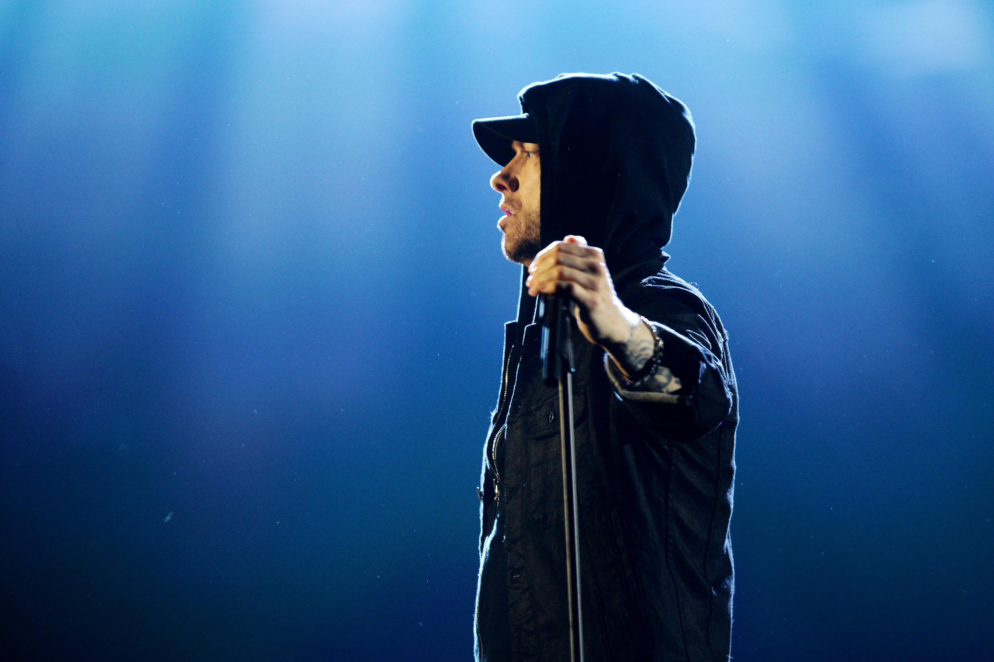 Eminem performs on stage.