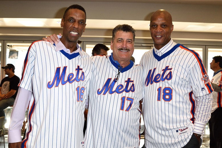 Dwight Gooden, Keith Hernandez, Darryl Strawberry smile while wearing Mets jerseys.