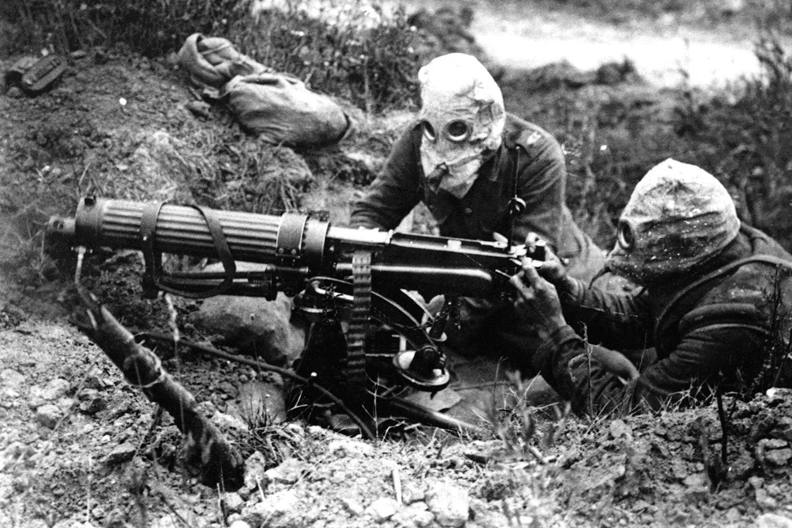 British machine gunners with gas masks on.
