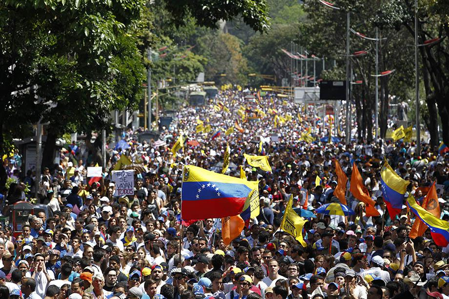 Opposition demonstrators take part in a protest against Venezuela's President Nicolas Maduro's government in Caracas.