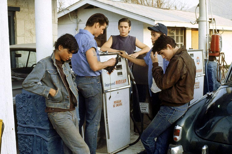 At a gas station: Tom Cruise, Matt Dillon, Rob Lowe, C. Thomas Howell, Ralph Macchio.