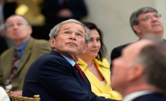 Former President George W. Bush looks at the 360-degree LED high-definition video wall inside the Freedom Hall in Dallas as he participates in a signing ceremony for the joint use agreement between the National Archive and the George W. Bush Presidential Center.