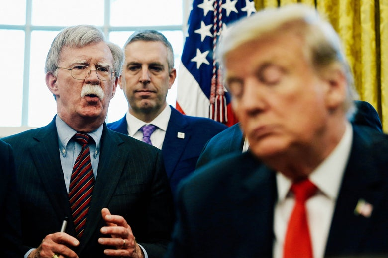 John Bolton speaks to Donald Trump in the Oval Office.
