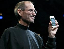 Steve Jobs holds the iPhone 4 in June 2010. Click image to expand.
