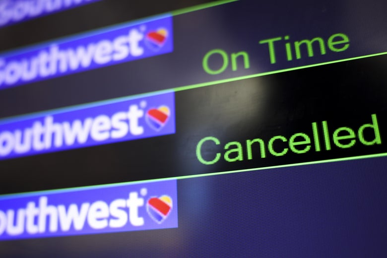 A screen displays Southwest Airlines flight information.