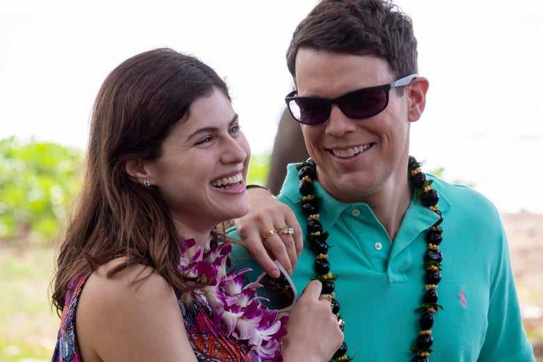 A smiling couple on a tropical beach.