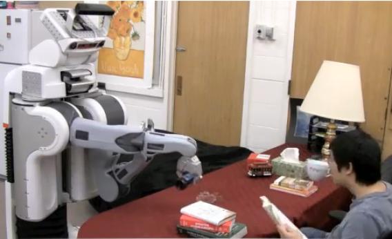 Robot pours beer, misses mug.