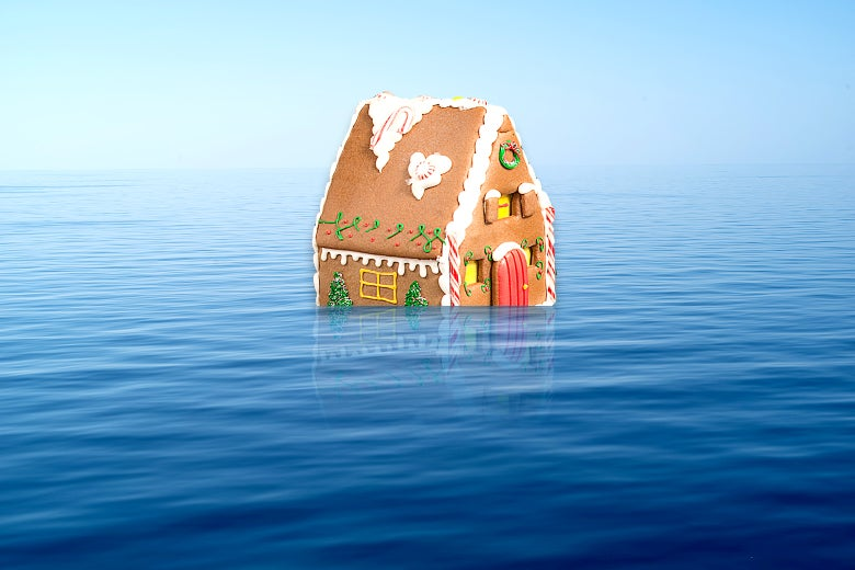 A gingerbread house floating in the middle of the ocean.