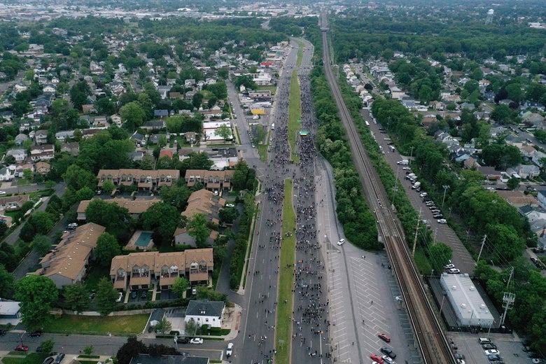 An aerial view of protesters marching down a large highway in Merrick, New York.