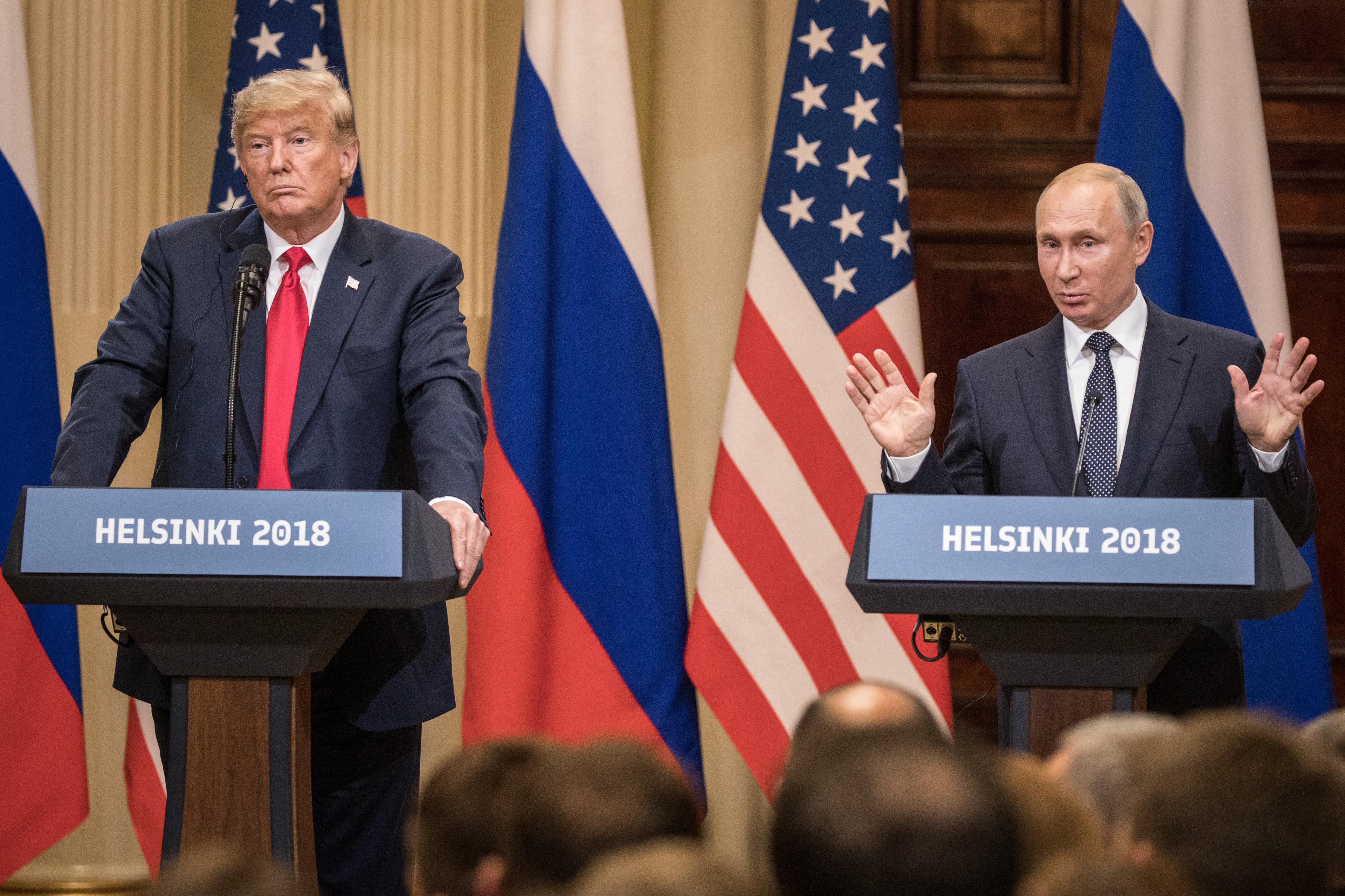 President Donald Trump, left, and Russian President Vladimir Putin answer questions