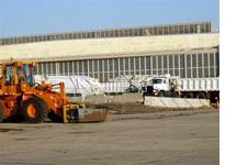 DSNY trucks in front of an old hangar