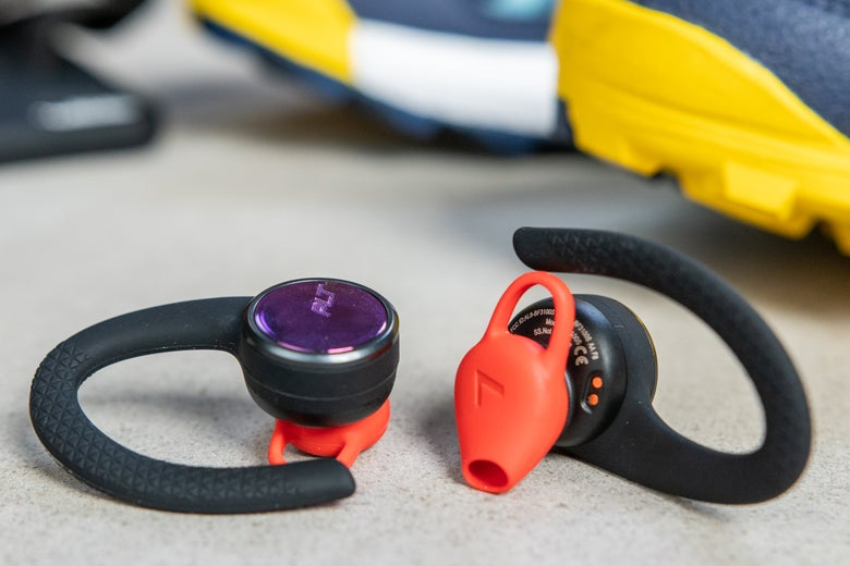 Plantronics BackBeat Fit 3100 headphones near sneakers.