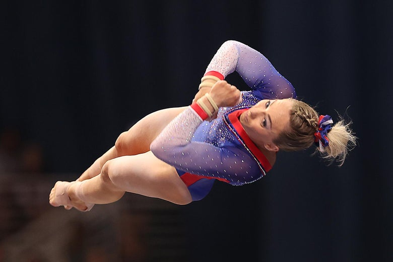 MyKayla Skinner flipping horizontally through the air, her legs and arms tucked tightly together, in a line with her torso