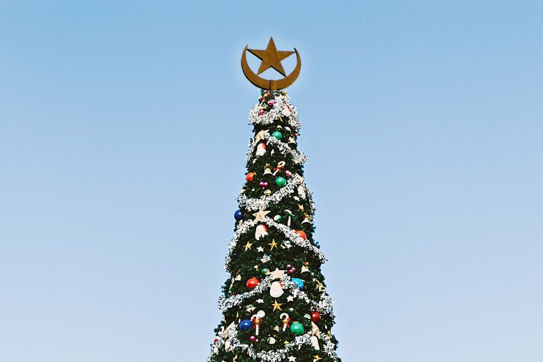 A Christmas tree with an Islamic star and crescent on top.