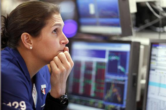 A trader works on the floor of the New York Stock Exchange August 19, 2011.