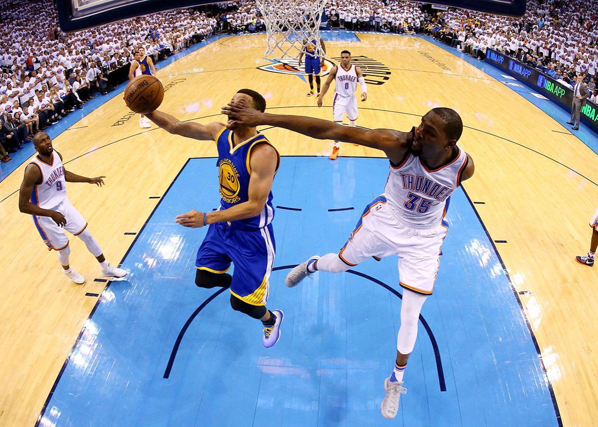 Stephen Curry of the Golden State Warriors goes up against Kevin Durant of the Oklahoma City Thunder during game four of the Western Conference Finals in Oklahoma City on Tuesday.