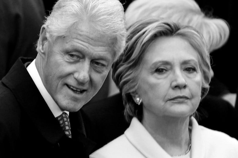 Former President Bill Clinton and former Democratic presidential nominee Hillary Clinton stand at the U.S. Capitol on Jan. 20, 2017 in Washington for President Donald Trump's inauguration.