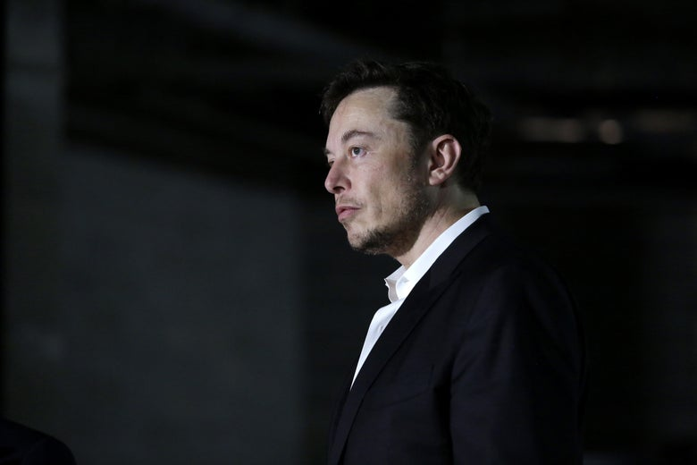 Elon Musk stands at a news conference on June 14 in Chicago. Maybe he is sleepy.