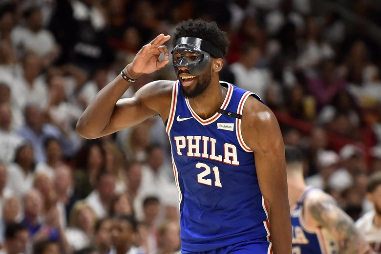 MIAMI, FL - APRIL 19: Joel Embiid #21 of the Philadelphia 76ers reacts after hitting a three pointer in the third quarter against the Miami Heat at American Airlines Arena on April 19, 2018 in Miami, Florida. NOTE TO USER: User expressly acknowledges and agrees that, by downloading and or using this photograph, User is consenting to the terms and conditions of the Getty Images License Agreement. (Photo by Eric Espada/Getty Images)