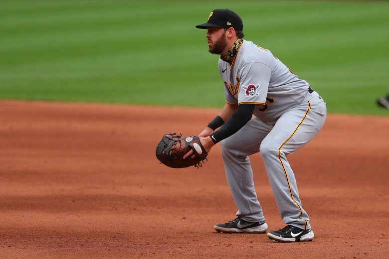 A player in a Pirates uniform plays first base.