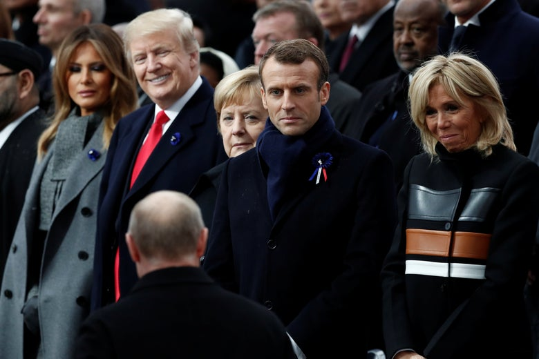 Russian President Vladimir Putin arrives to take his place with French President Emmanuel Macron, Brigitte Macron, German Chancellor Angela Merkel, President Donald Trump, and first lady Melania Trump at the Arc de Triomphe in Paris, France on November 11, 2018.