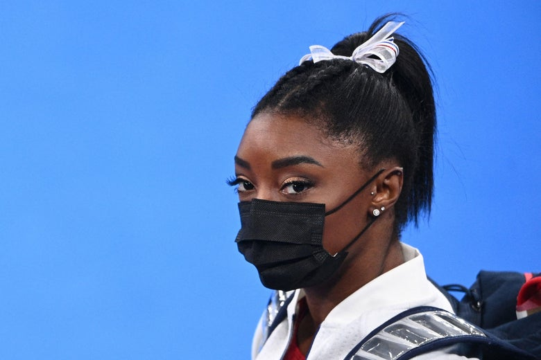 Biles in a mask looking stonefaced