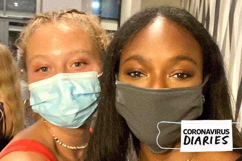 Two friends, freshmen in college, wearing masks.