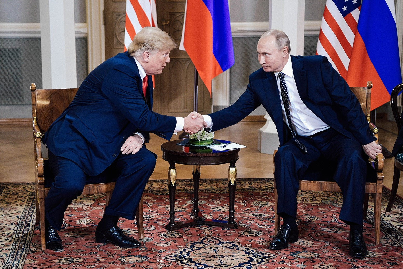 President Donald Trump shakes hands with Russia's President Vladimir Putin during a meeting in Helsinki, Finland, on Monday.