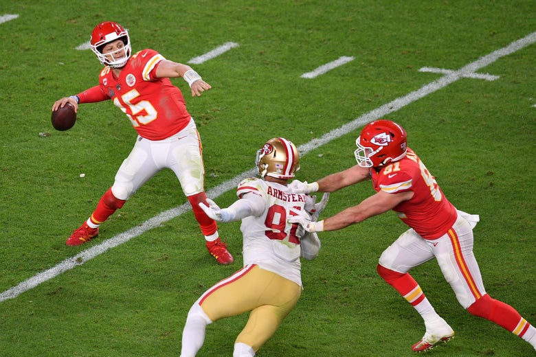Mahomes passes the ball as a 49ers linebacker rushes him and is blocked by a Chiefs lineman, during the Super Bowl.